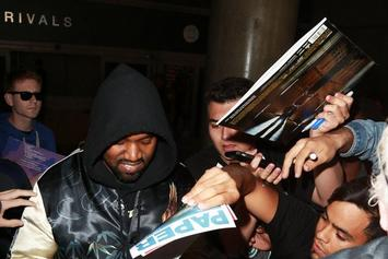 Kanye West Breaks Up A Paparazzi Fight With A Hug