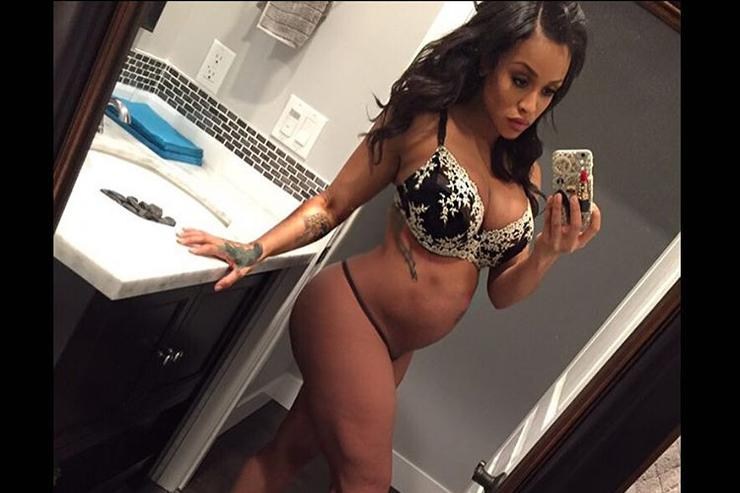 Masika Kalysha showing off her pregnant stomach