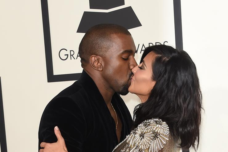 Rapper Kanye West (L) and TV personality Kim Kardashian attend The 57th Annual GRAMMY Awards at the STAPLES Center on February 8, 2015 in Los Angeles, California.