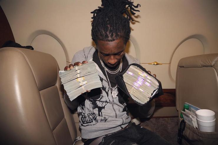 Young Thug with piles of cash