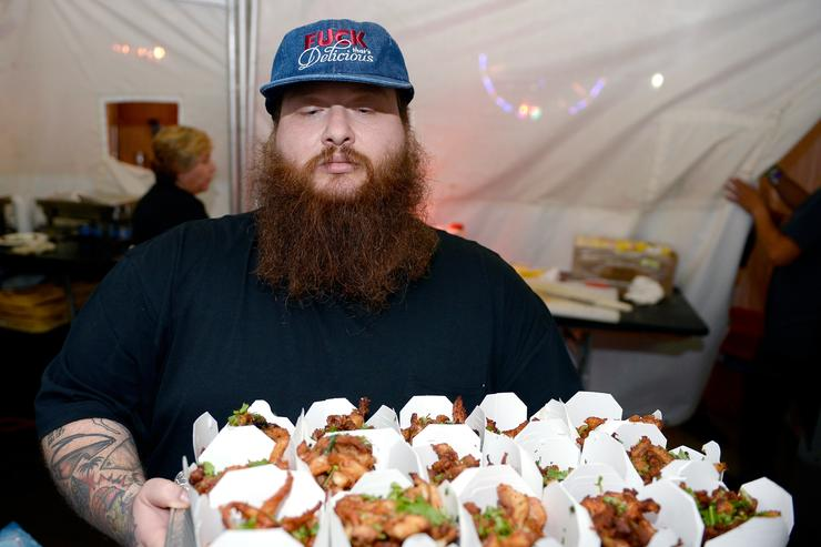 Action Bronson with tray of food at Tyler The Creators 5th annual Camp Flog Gnaw.