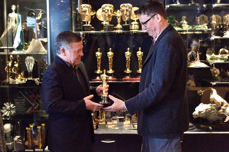 King Abdullah II ibn Al Hussein of Jordan (L) with Sir Richard Taylor holds one of Sir Richard's Academy Awards during a visit to Weta Workshops on November 29, 2016 in Wellington, New Zealand. King Abdullah II ibn Al Hussein of Jordan is in New Zealand for a 4 day visit.