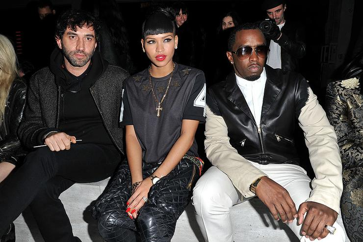Riccardo Tisci, Cassie Ventura and Sean Combs attend the Kanye West Ready-To-Wear Fall/Winter 2012 show as part of Paris Fashion Week at Halle Freyssinet on March 6, 2012 in Paris, France.