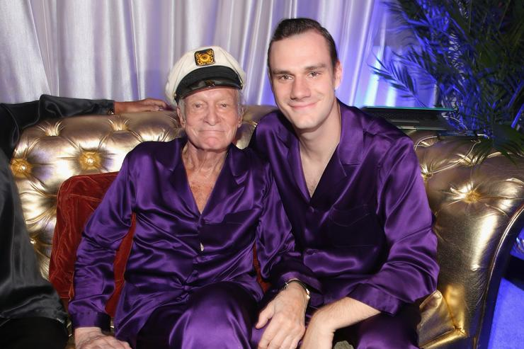 Hugh Hefner (L) and Cooper Hefner attend the Annual Midsummer Night's Dream Party at the Playboy Mansion hosted by Hugh Hefner on August 16, 2014 in Holmby Hills, California.
