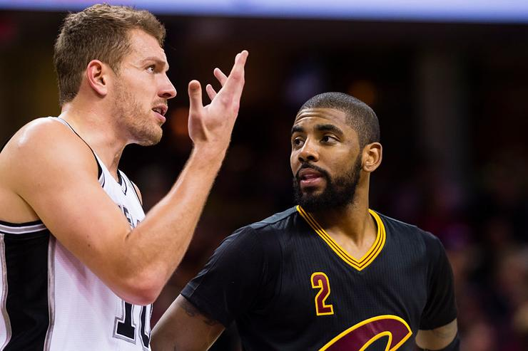 David Lee #10 of the San Antonio Spurs talks to Kyrie Irving #2 of the Cleveland Cavaliers on the court during the first half at Quicken Loans Arena on January 21, 2017 in Cleveland, Ohio.